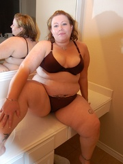 Tattoed bbw milf slowly taking off her undies in front - Picture 4