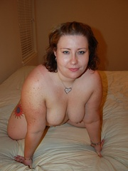Tattoed bbw milf slowly taking off her undies in front - Picture 10