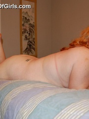 Check out these huge boobs and fat ass of plump redhead - Picture 9