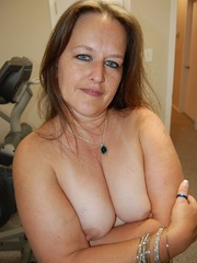 Busty chubby mature mom spreads her legs to show her wet - Picture 12