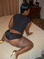 Nasty black housewife in black panties teasing on the - Picture 6