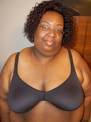 Check out enormous ebony mom stips naked in her bedroom. - Picture 3