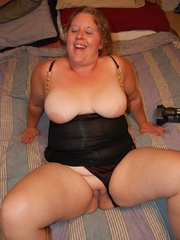 Busty BBW mom with huge breasts in her sexy black outfit - Picture 8