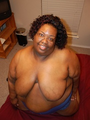 Check out enormous ebony mom stips naked in her bedroom. - Picture 8