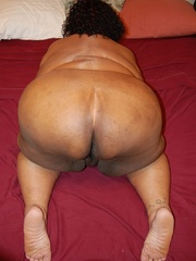 Check out enormous ebony mom stips naked in her bedroom. - Picture 12