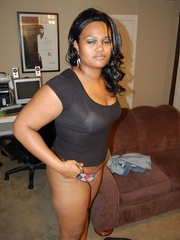 Lusty black chubby housewife spreading her legs wide sou - Picture 2