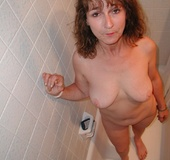 Big boobed slim granny slowly undressing in front&hellip;