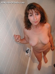 Big boobed slim granny slowly undressing in front of a - Picture 4