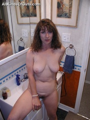 Big boobed slim granny slowly undressing in front of a - Picture 5