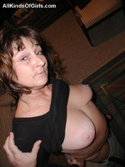 Big boobed slim granny slowly undressing in front of a - Picture 10