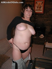 Big boobed slim granny slowly undressing in front of a - Picture 11