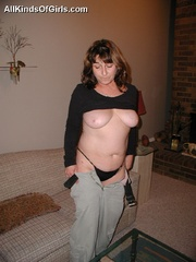 Big boobed slim granny slowly undressing in front of a - Picture 12