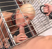 Blonde enslaved teen forced to suck cock in a cage…