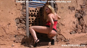 Kinky blonde in a red dress and high heels fisting her slammed asshole at the abandoned house - XXXonXXX - Pic 4