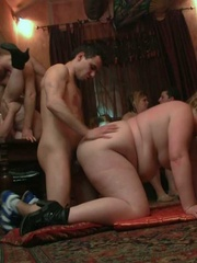 The orgy unfolds with the BBW on her hands and knees - Picture 7