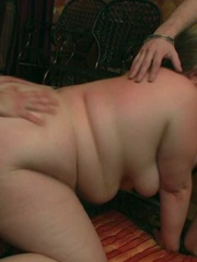 The orgy unfolds with the BBW on her hands and knees - Picture 9