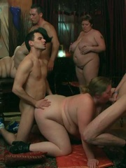 The orgy unfolds with the BBW on her hands and knees - Picture 12