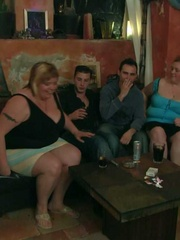 The fatties are half-naked in the bar and sucking cock - Picture 3
