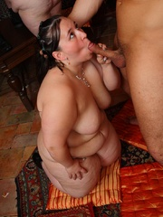 She gives a blowjob as the BBW orgy goes on around her - Picture 6