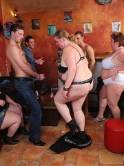 The plumper is on top of her man in the orgy and she - Picture 1