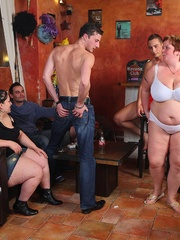 The BBW orgy in the bar features a hot fatty with jiggly - Picture 1