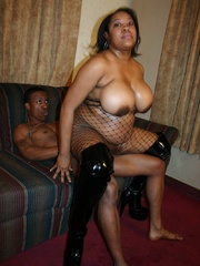 Those big brown boobs blossom out of her fishnet - Picture 12