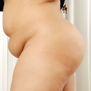 Chunky Asian gets naked and shows her fat pussy - Picture 4
