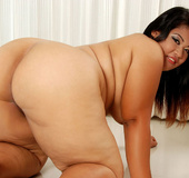 Plump Asian Sunny shows her thick legs and firm…