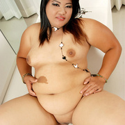 Chunky Asian gets naked and shows her fat pussy - Picture 10
