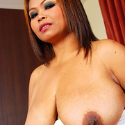 Horny Asian milf shows what shes hiding under her dress - Picture 9