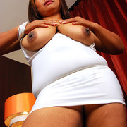 Horny Asian milf shows what shes hiding under her dress - Picture 12