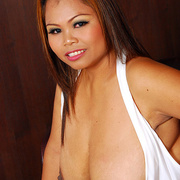 Horny Asian milf shows what shes hiding under her dress - Picture 13