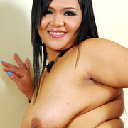 Horny chubby Asian Aum has fun showing her ass - Picture 12