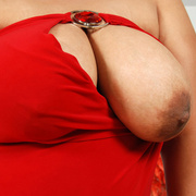 Curvaceous Asian girl plops out her tits - Picture 9