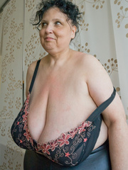 Curly brunette mature demonstrates her enormous boobs - Picture 4
