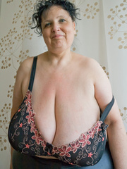 Curly brunette mature demonstrates her enormous boobs - Picture 7