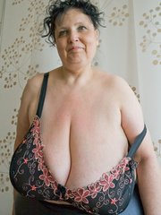 Curly brunette mature demonstrates her enormous boobs - Picture 8