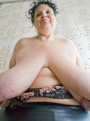 Curly brunette mature demonstrates her enormous boobs - Picture 15