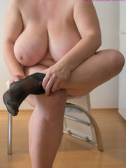 Big-titted MILF putting on black stockings to look - Picture 6