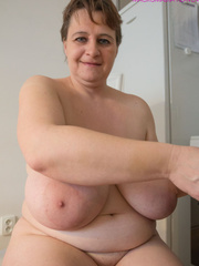 Big-titted MILF putting on black stockings to look - Picture 14