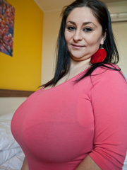 Busty brunette mom in a pink pull-over sucking her huge - Picture 9