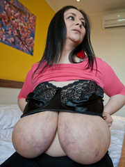 Busty brunette mom in a pink pull-over sucking her huge - Picture 12