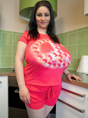 Brunette MILF in pink shorts and T-shirt flaunting - Picture 1