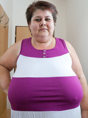 Old fat slut with gigantomastia gets naked - Picture 3