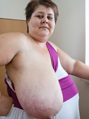 Old fat slut with gigantomastia gets naked - Picture 7