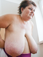 Old fat slut with gigantomastia gets naked - Picture 11