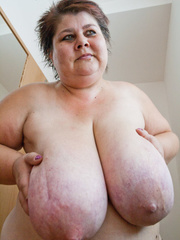 Old fat slut with gigantomastia gets naked - Picture 12