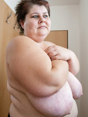Old fat slut with gigantomastia gets naked - Picture 14