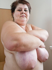 Old fat slut with gigantomastia gets naked - Picture 15
