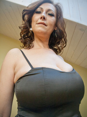 Very hot busty mature takes off her black dress and - Picture 1